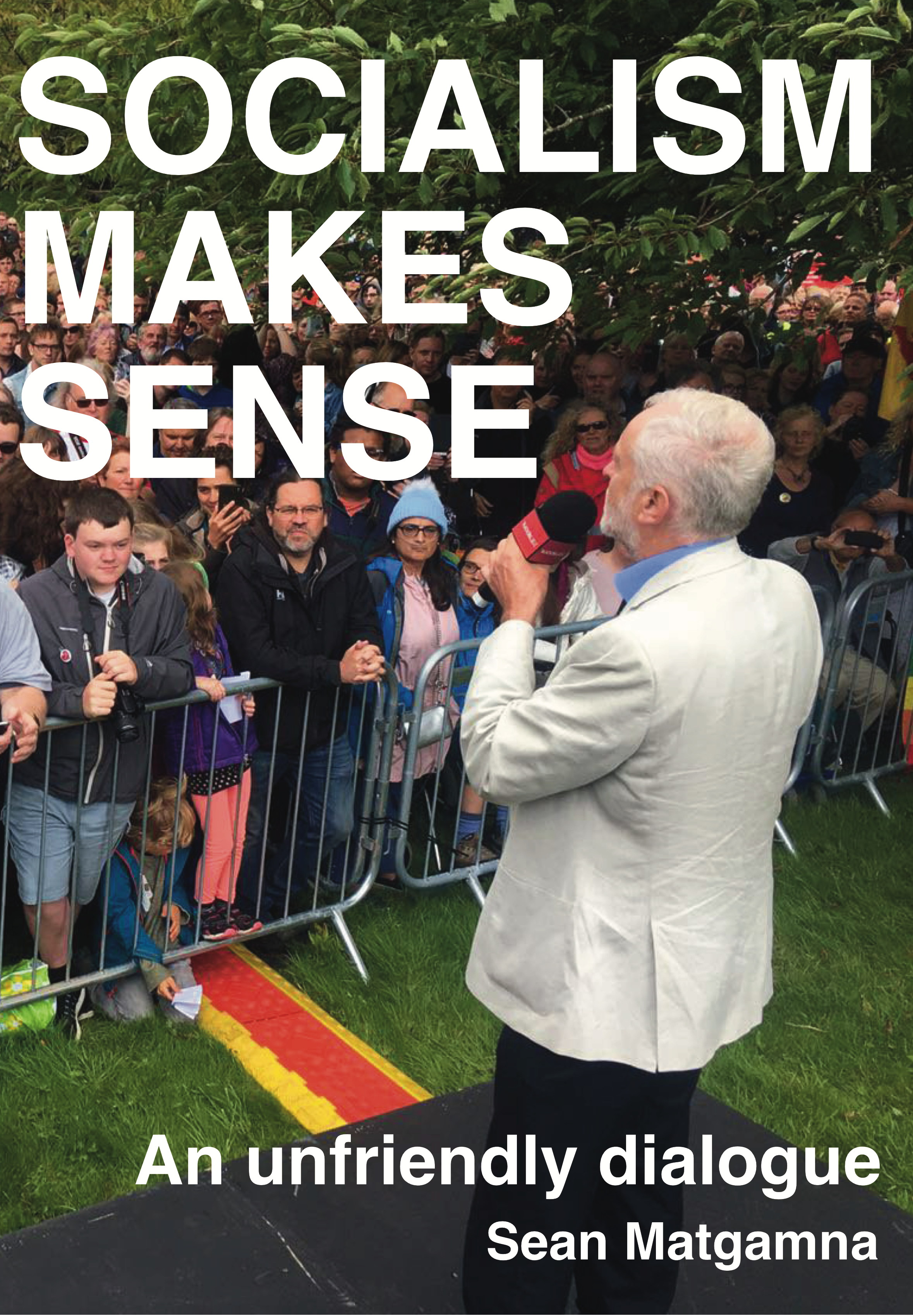 Image of the front cover of Socialism Makes Sense book with Corbyn speaking to a crowd