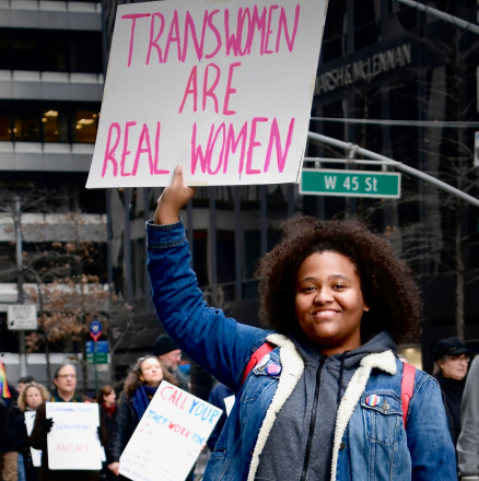 "Placard reading ""Trans women are real women"""