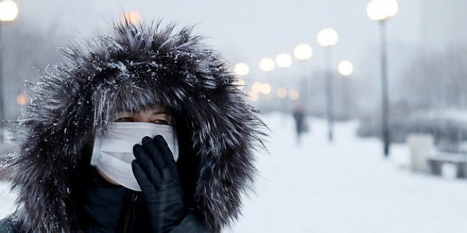 Woman with mask in snow