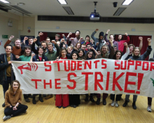 "A crowd with a banner reading ""Students support the strike"""
