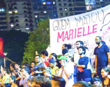 "Protesters hold a banner reading ""who killed Marielle?"" at protests after Marielle Franco's death"