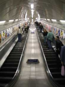 A photograph of escalators at a London Underground station.