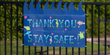"Sign on a school gate reading ""Thank you.  Stay safe!"""
