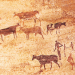 Cave painting of men and cattle
